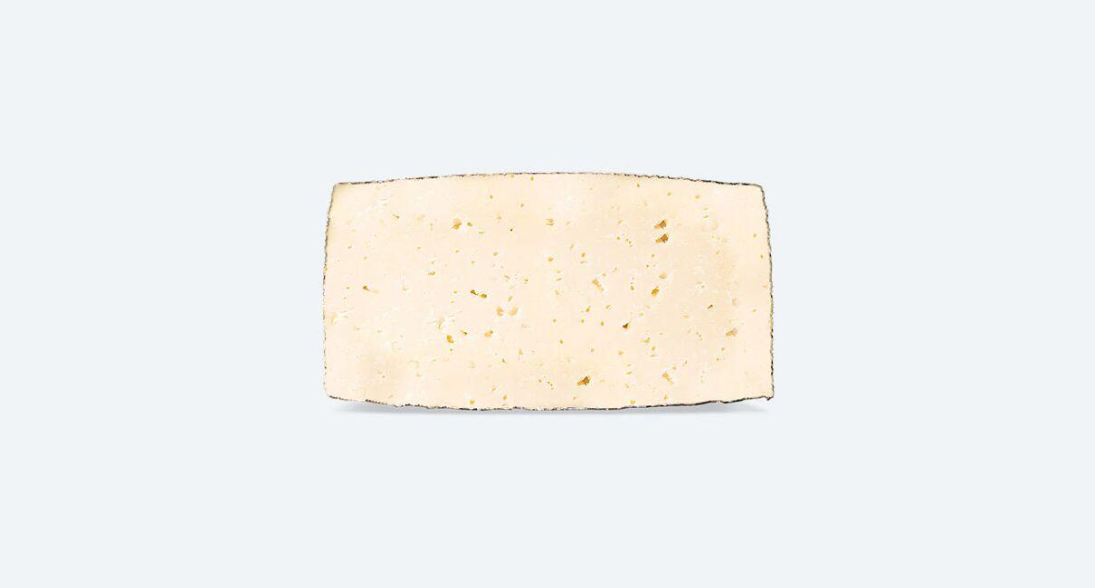 Queso de Leche Pasteurizada de Oveja Curado cortada la mitad